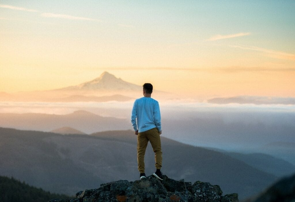 VETS2INDUSTRY | Man standing on top of a mountain trying to decide where his career is going to go